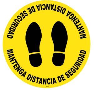 Señalización adhesiva suelo antideslizante distancia de seguridad covid-19. Huella color amarillo y negro.